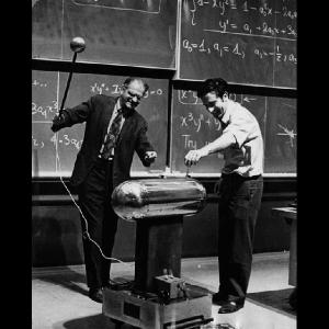Victor F. Weisskopf and Michael S. Feld, demonstrating with a small van de Graaff generator. Photo courtesy MIT Museum.